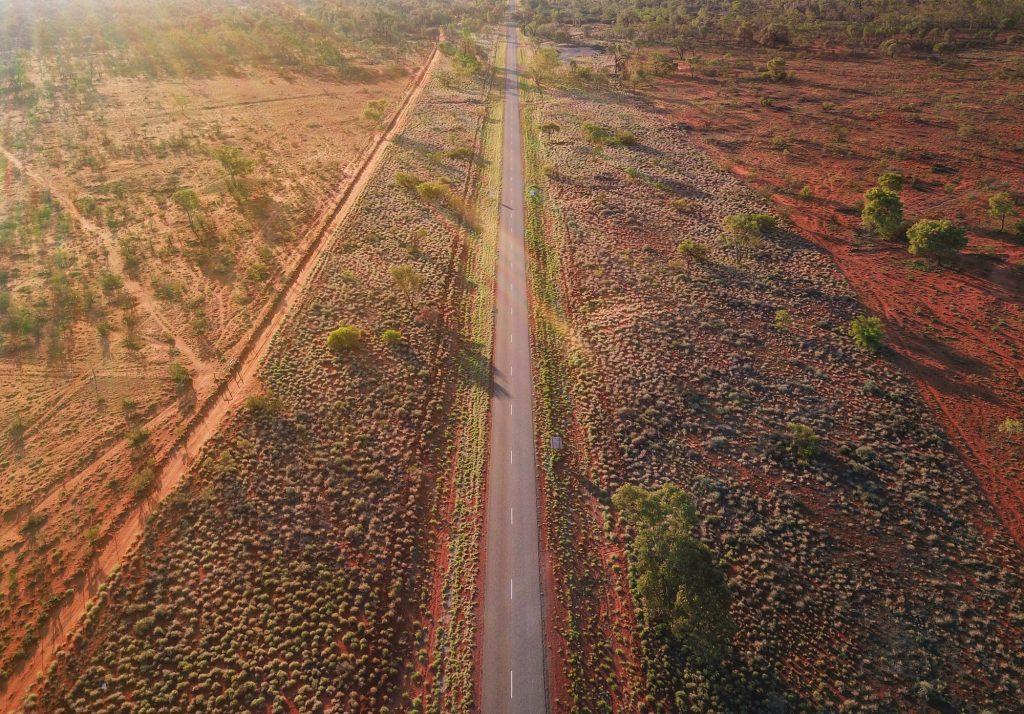 An aerial view of a long road in the Australian Outback. Empty roads during Covid 19.